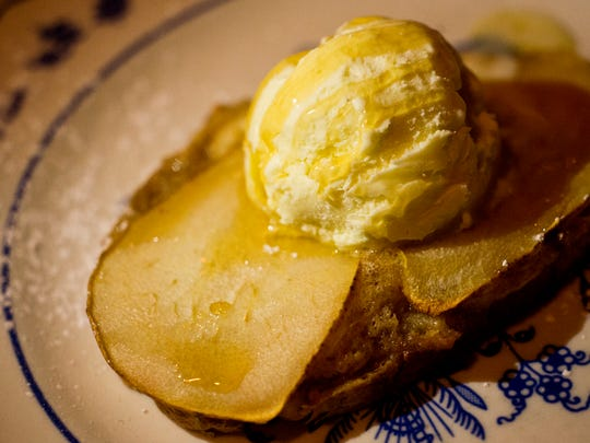 Pear bruschetta and house-made rosemary ice cream, drizzled with local honey, at Trapp Family Lodge in Stowe.