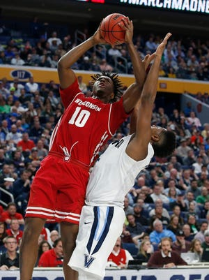 Wisconsin Badgers forward Nigel Hayes  shoots over Villanova Wildcats forward Kris Jenkins.