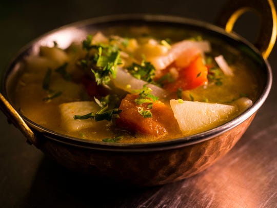Traditional vegetable soup with peppers, cauliflower,