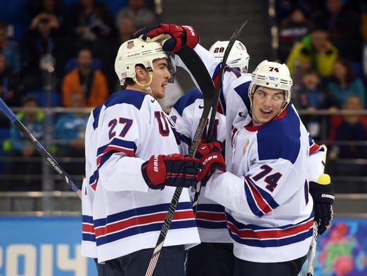 Forward T.J. Oshie congratulates defenseman Ryan McDonagh on his goal in Team USA's 5-1 win over Slovenia.