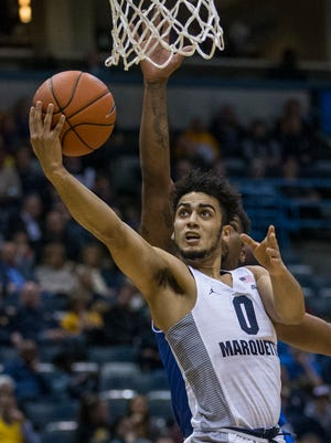 Marquette's Markus Howard will have his hands full with Billy Garrett on Saturday.