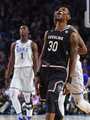 South Carolina forward Chris Silva (30) reacts after
