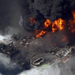 The Deepwater Horizon oil rig burns in the Gulf of Mexico, more than 50 miles southeast of Venice. BP and five Gulf states announced an $18.7 billion settlement Thursday.