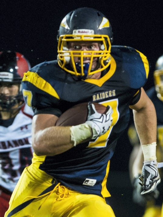Elco's Tyler Horst finds running room on the way to piling up 177 yards and two touchdowns.