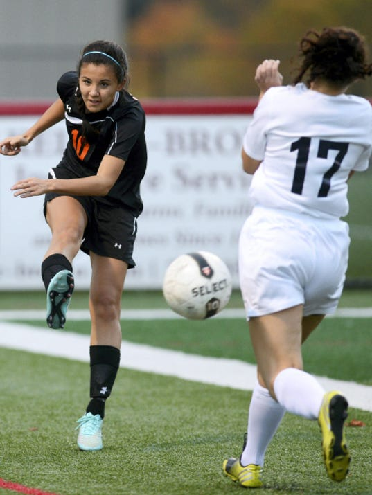 Central York's Kennedy Little kicks the ball past Dallastown's Alexandra Brunell during last year's YAIAA championship game at Susquehannock High School. Little is one of three area high school players to give verbal commitments to Division I colleges this summer. She'll attend Elon, about 20 miles east of Greensboro, N.C.
