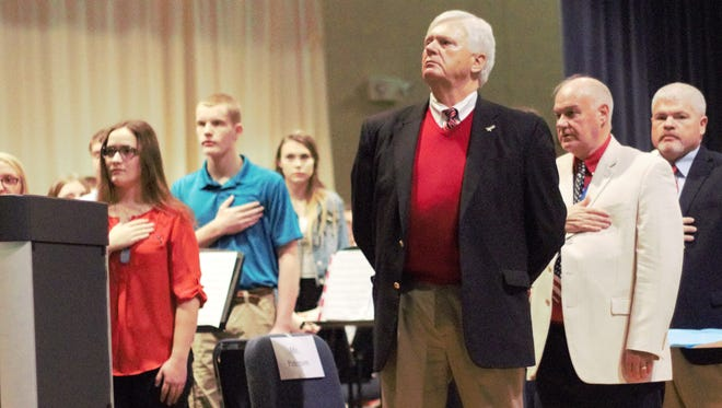 Superintendent Jim Peterson stands along students and faculty during the pledge of allegiance at River Valley High School on Friday during the annual Veterans Day celebration.