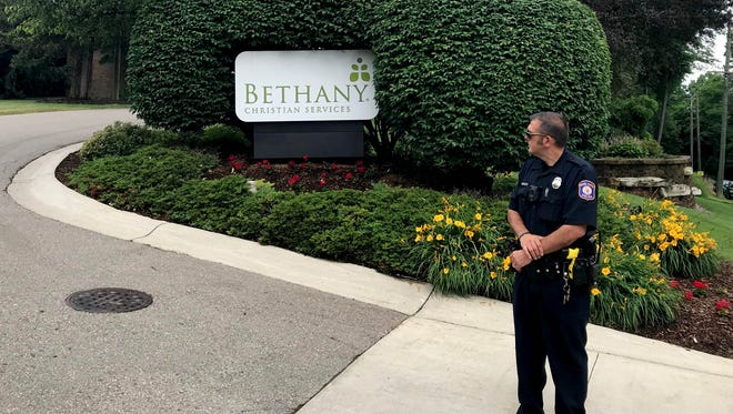 A police officer stands at the entrance to Bethany Christian Services in Grand Rapids on June 27, 2018. Bethany has taken in about 50 immigrant children separated from their parents after they crossed the southern border.