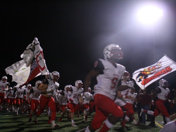 Chaparral runs onto the field before the game against