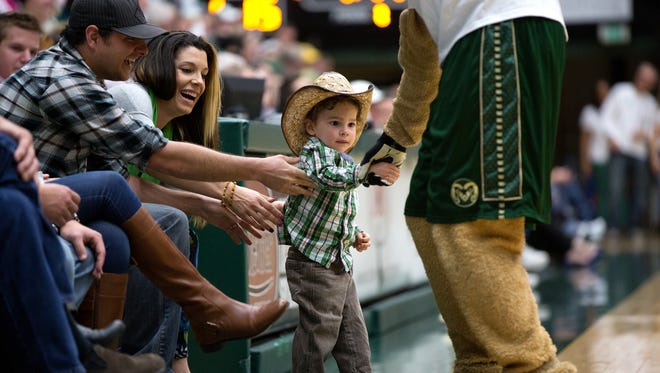 A young Colorado State University fan says hello to CAM the Ram in January.