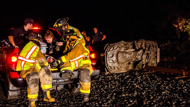 A pickup truck was called in to transport the victim from the railroad tracks to the awaiting ambulance.