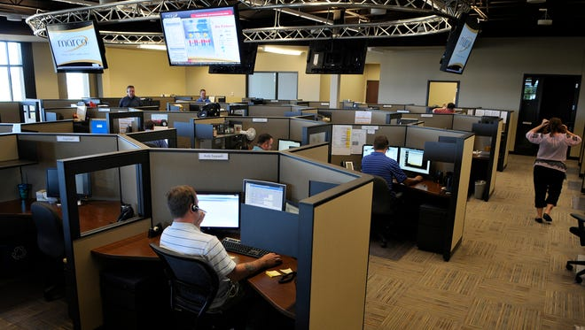 Marco employees work in the command center at company headquarters in this 2012 file photo.