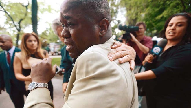 Charlie Bothuell IV becomes emotional June 25, 2014, after learning that Detroit officers found his 12-year old son, missing for 11 days.