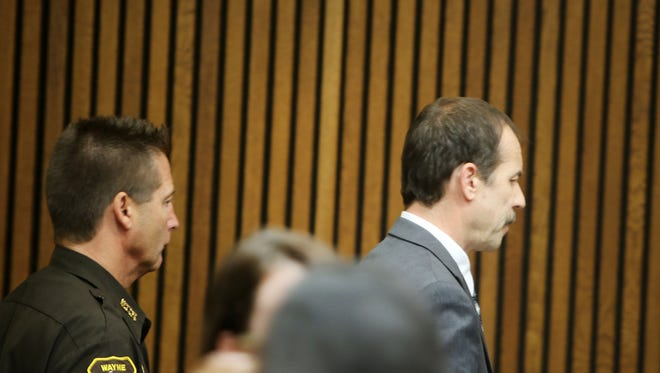 Theodore Wafer of Dearborn Heights, Mich., is taken away after being sentenced to 17-30 years Wednesday, Sept. 3, 2014, after being found guilty of second-degree murder in the shooting death of Renisha McBride.