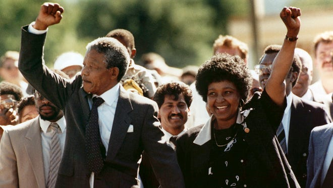 Nelson Mandela and his wife, Winnie, walk out of the Victor Verster prison in Paarl on Feb. 11, 1990.