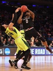South Carolina Gamecocks guard Sindarius Thornwell (0) drives to the basket against Baylor Bears guard Ishmail Wainright (24) during the first half in the semifinals of the East Regional of the 2017 NCAA Tournament at Madison Square Garden.