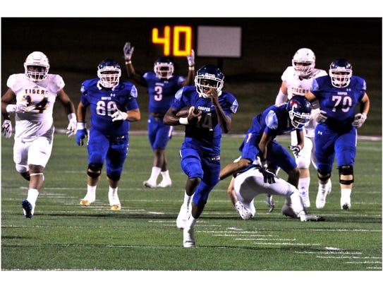 Cooper High School running back Maurice Johnson sprints