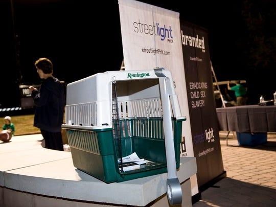 Peggy Bilsten would carry a dog crate to help spread her message.