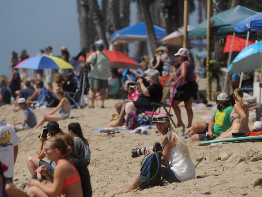 People crowd the beach to watch surfers during the 2014 Aloha Beach Festival and surfing competition at Surfers Point and Promenade Park in Ventura.