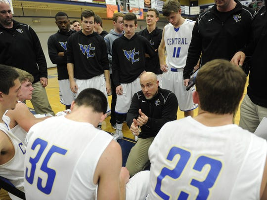 Troy Bond instructs his Wilson Central basketball team during a timeout in the 2014 Class AAA boys basketball state tournament.