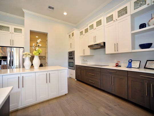 The large kitchen features a walk-in pantry.