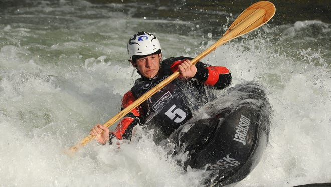Top, Reno's Jason Craig competes in the freestyle kayaking finals during the 11th annual Reno River Festival in 2014.