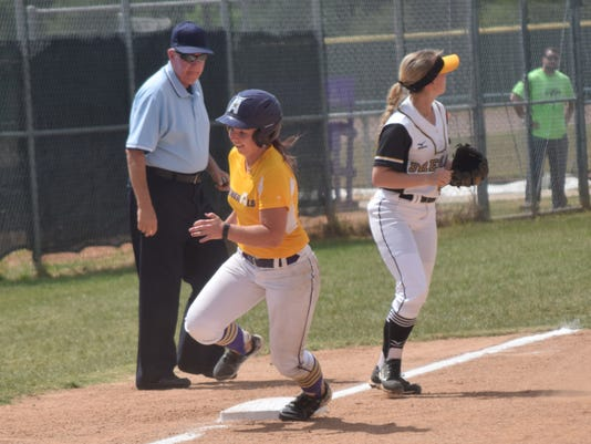 LSUA's Kimber Gruehl (11) rounds third on her way to scoring LSUA's second run in LSUA's matchup with Brenau University in the NAIA Softball Champship opening round held Tuesday.