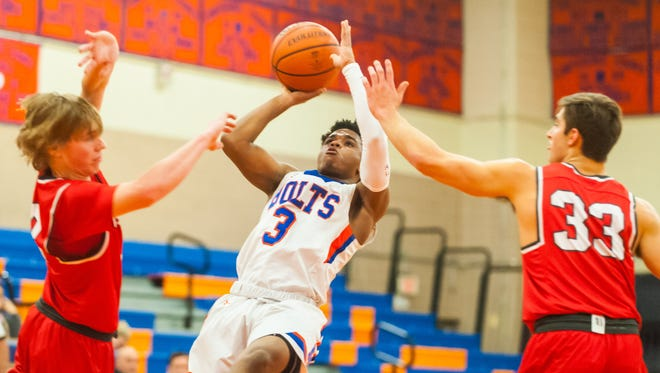 Millville's Terrell Davis (3) is tripped up while shooting against Lenape at Millville High School on Tuesday, February 27.