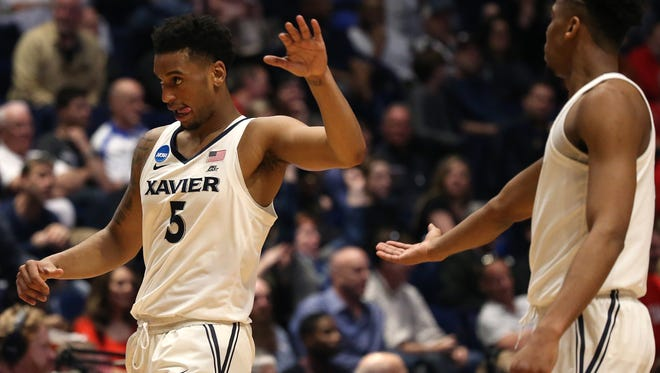 Xavier Musketeers guard Trevon Bluiett (5) and Xavier Musketeers guard Paul Scruggs (1) high five in the first half of the first-round NCAA Tournament game between the Xavier Musketeers and the Texas Southern Tigers, Friday, March 16, 2018, at Bridgestone Arena in Nashville.