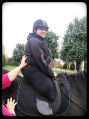 Tina Elliott, 43, of Riverside, got back up on a horse after losing her legs to infection last year.