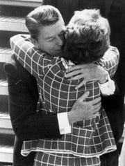 Ronald Reagan hugs his wife, Nancy, during the 1982
