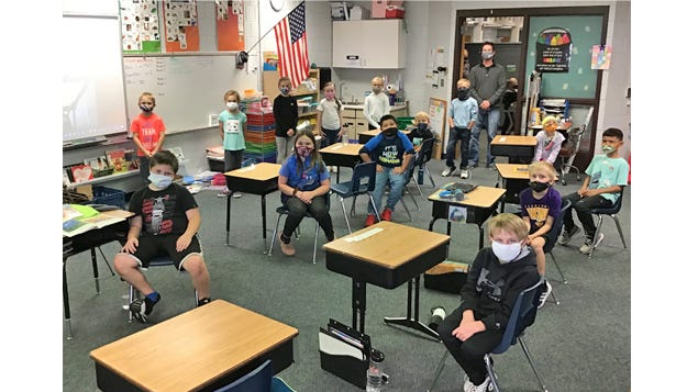 Mr. Weicherding's 2nd grade class at Sleepy Eye Public School are happy to show how well they've adapted to wearing masks at school and tell how glad they are to be back.