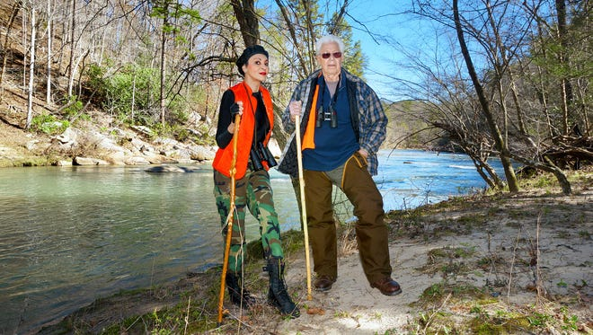 Regina Lynch-Hudson and her uncle, Wallace Lynch, pause by the Broad River in Rutherford County in their search for the place where Wallace Lynch grew up.