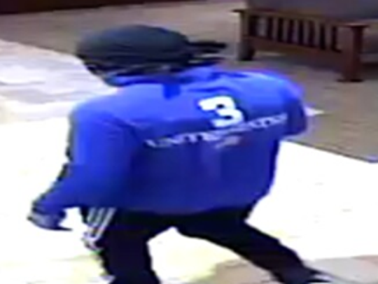 Surveillance photo of a man suspected of robbing a