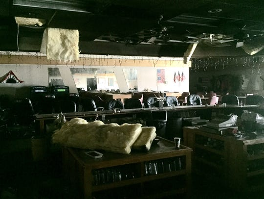 The bar area of the Moose Lodge was heavily damaged