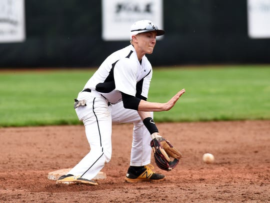 Tri-Valley second baseman Seth Wolford fields a throw from catcher Dalton Crowley during the Scotties' 1-0 win against John Glenn.