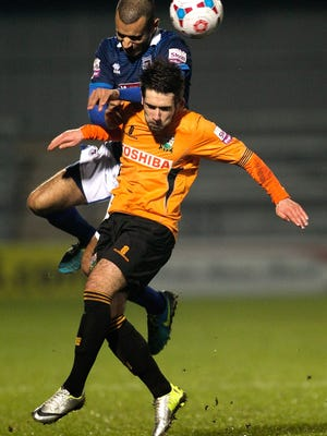 BARNET, ENGLAND - FEBRUARY 18: Charlie Adams of Barnet battles in the air with Paul Bignot of Grimsby during the Skrill Conference Premier League match between Barnet and Grimsby Town at The Hive Stadium on February 18, 2014 in Barnet, England.  (Photo by Ben Hoskins/Getty Images)