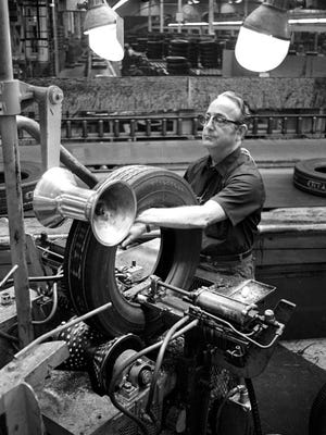 An inspector checks tires coming off the assembly line at the Firestone Tire & Rubber plant on Dec. 1, 1972. The plant opened in 1937 and at one time employed approximately 1,600 people. At the time shutdown proceedings began, there were approximately 1,000 employees. The plant, which had 1.4 million square feet and occupied 85 acres on Firestone, closed in March of 1983.