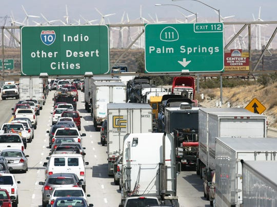 Cars and trucks sit in traffic on the Interstate 10