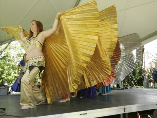 Jeannine Cutting, of Ithaca, performs with the Mirage Belly Dancers during the 2014 Ithaca Festival.