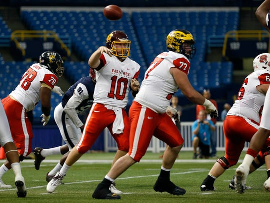 East Team quarterback Cooper Rush (10) throws the ball during the second quarter of the East-West Shrine Game at Tropicana Field.