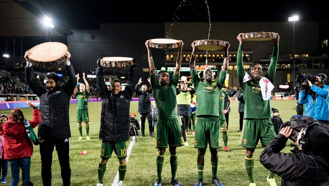 Portland Timbers midfielder Diego Valeri (far left) and midfielder Sebastian Blanco (10) and defender Alvas Powell (2) and midfielder Lawrence Olum (13) and forward Fanendo Adi (far right) celebrate after a game against Minnesota United at Providence Park. The Timbers won 5-1.