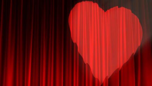 Red velvet texture illuminated by a heart shaped spotlight