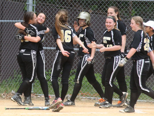 Clarkstown South players celebrate their 5-4 win over