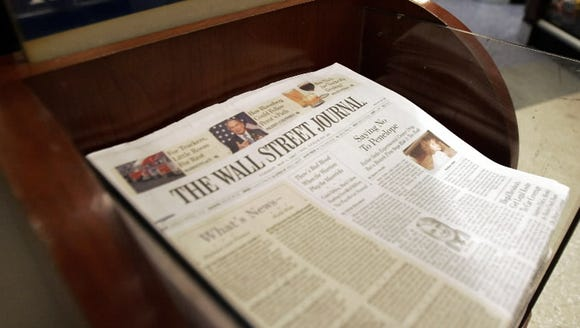 The Wall Street Journal is shown on sale at Hudson