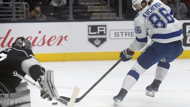 Tampa Bay Lightning right wing Nikita Kucherov scores a goal against Los Angeles Kings goalie Jonathan Quick.