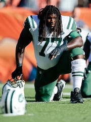 New York Jets offensive guard James Carpenter (77) looks on before the game against the Denver Broncos at Sports Authority Field at Mile High on Dec.10, 2017.