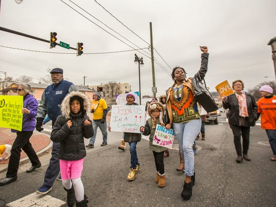 Marchers make their way up Fourth Street as they march for peace to commemorate Martin Luther King Jr.'s legacy on Martin Luther King Jr. Day on Monday.