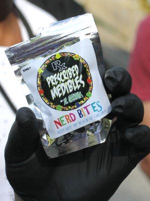 Richland County Sheriff Capt. Donald Zehner holds up a bag of THC-laced candy during a press conference. The candy had been distributed to concert-goers at Ohio Dreams, resulting in 24 people going to the hospital.