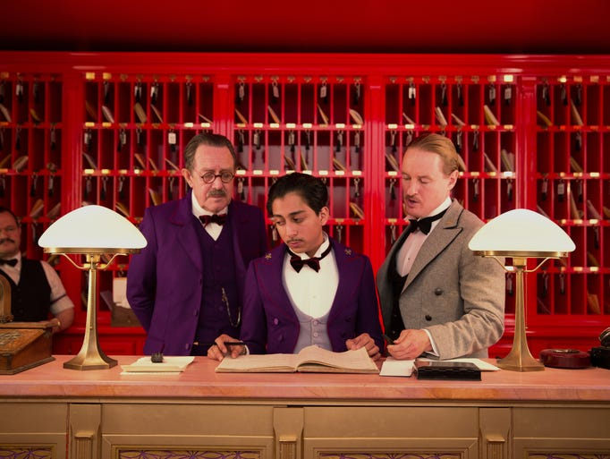 """This image released by Fox Searchlight shows Tom Wilkinson, Tony Revolori, center, and Owen Wilson, right,  in """"The Grand Budapest Hotel."""""""