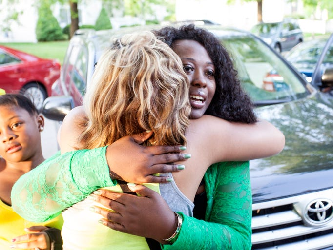 Metro District 1 winner Jessica Green is embraced by supporters upon arriving at her victory party in the West End.